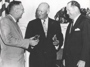 President Eisenhower commissions Dr. T. Keith Glennan as first administrator and Dr. Hugh Dryden as assistant administrator